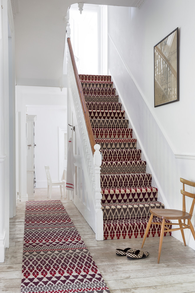 Classic carpeted u-shaped staircase in Hampshire with carpeted risers.