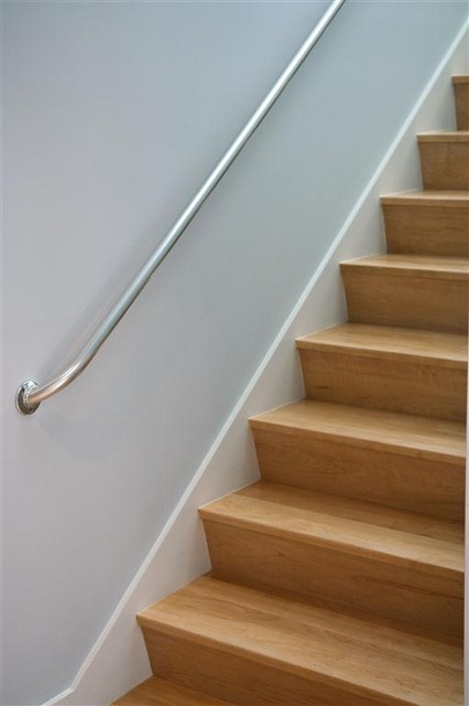 Elegant Angled Riser Maple Stairs. Modern Staircase