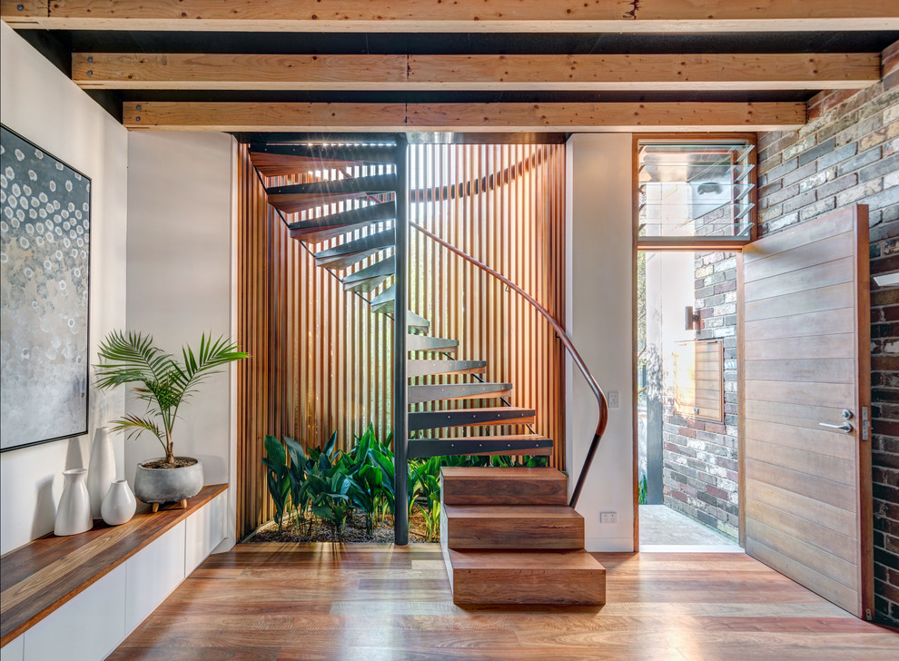 Example of a mid-sized urban wooden spiral wood railing and open staircase design in Sydney