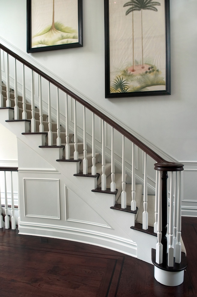 Example of a classic wooden wood railing staircase design in San Francisco