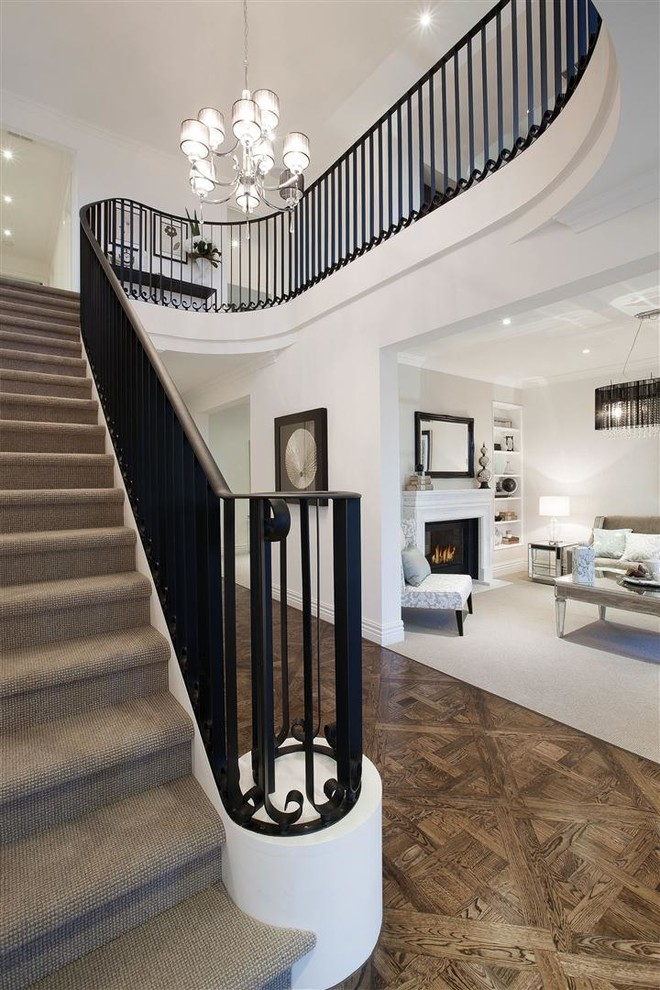 Large traditional carpeted curved staircase in Melbourne.