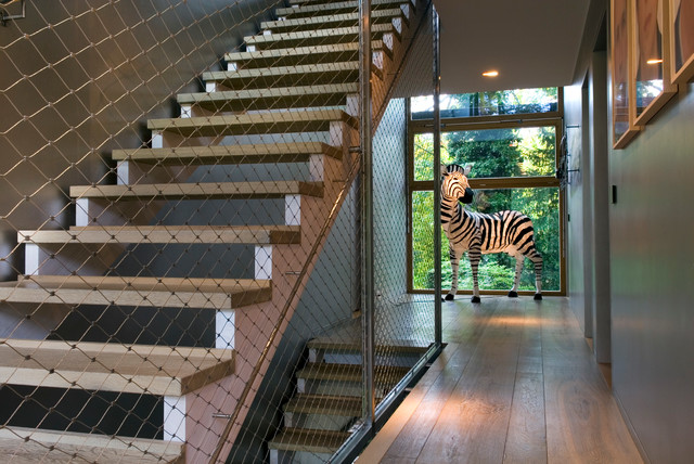 Inspiration for a contemporary wooden open staircase remodel in Other