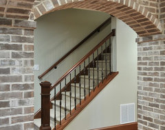 Basement with Brick Arches traditional-staircase