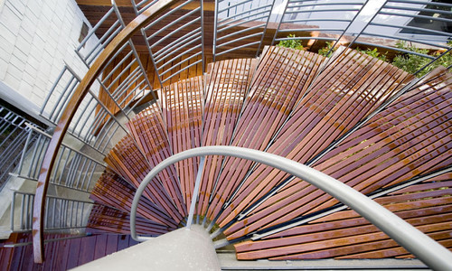 spiral stairs and wooden slat treads