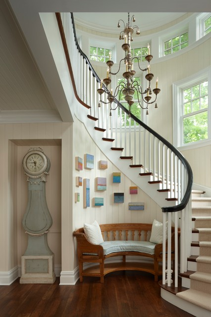 Inspiration for a large beach style wooden curved staircase remodel in Other with wooden risers