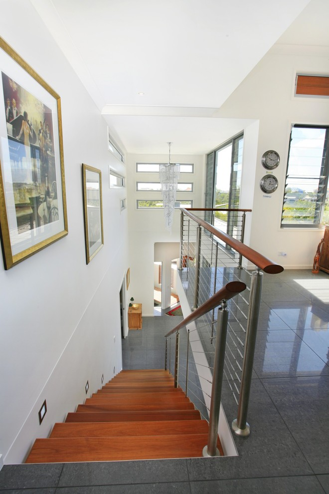 Trendy wooden staircase photo in Sunshine Coast