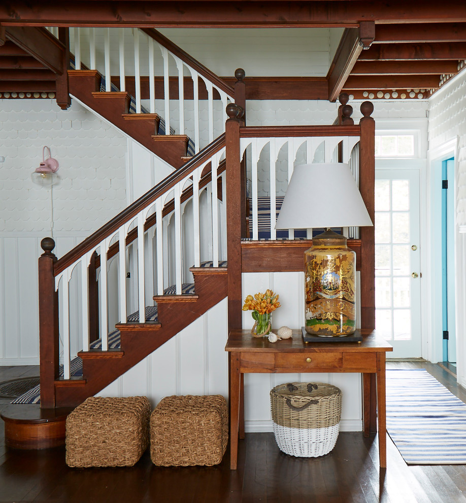 Example of a mid-sized beach style carpeted u-shaped wood railing staircase design in Portland Maine