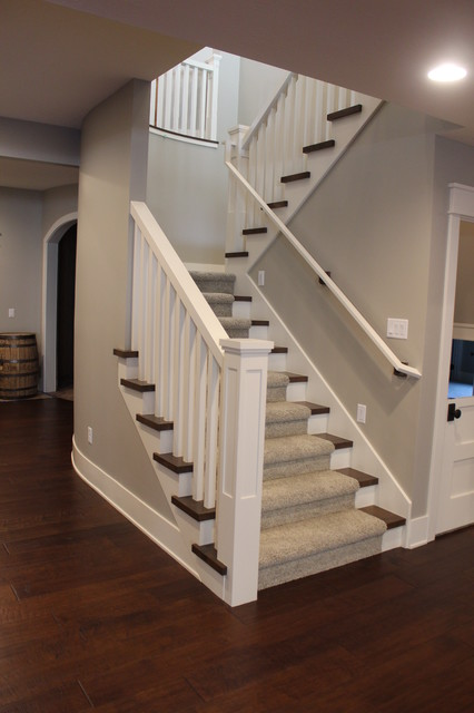 Inspiration for a large transitional carpeted l-shaped staircase remodel in Salt Lake City with wooden risers