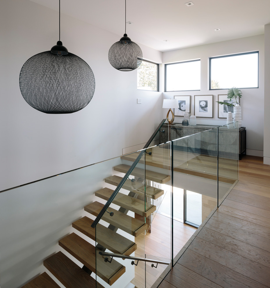 Example of a mid-sized trendy wooden u-shaped metal railing staircase design in Vancouver with wooden risers