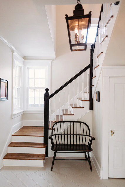 Black white entryway farmhouse staircase chicago for Foyer staircase decorating ideas