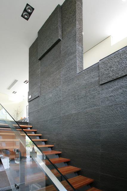 Black Granite   Striated modern-staircase