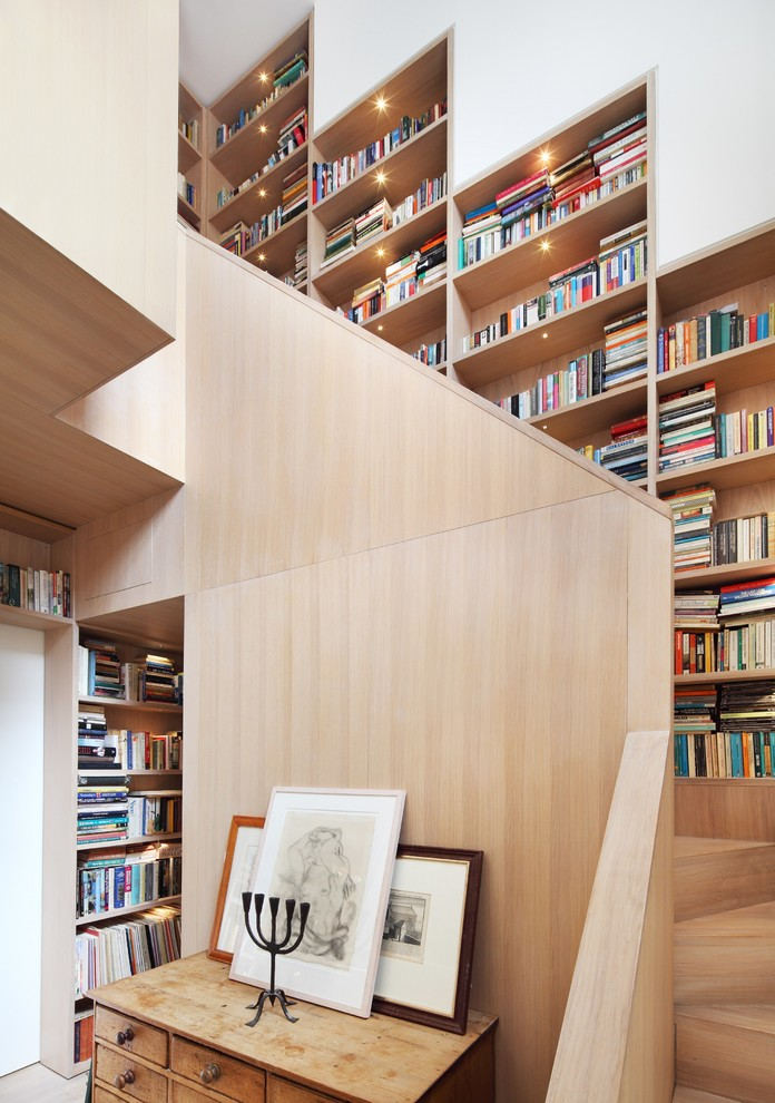 Staircase - contemporary wooden curved staircase idea in London with wooden risers
