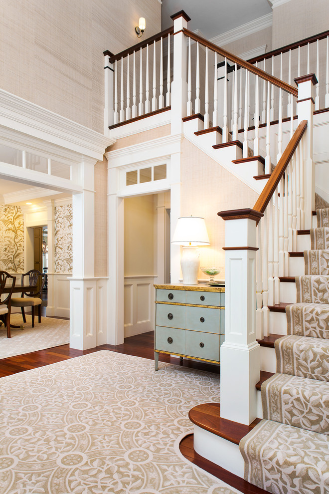 Example of a classic wooden l-shaped staircase design in Boston with painted risers