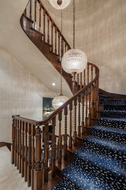 Design ideas for a large classic carpeted curved staircase in Orange County with wood risers.