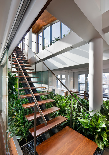 Example of a trendy wooden straight open staircase design in New York