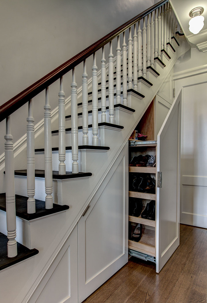 Example of a classic wooden staircase design in New York