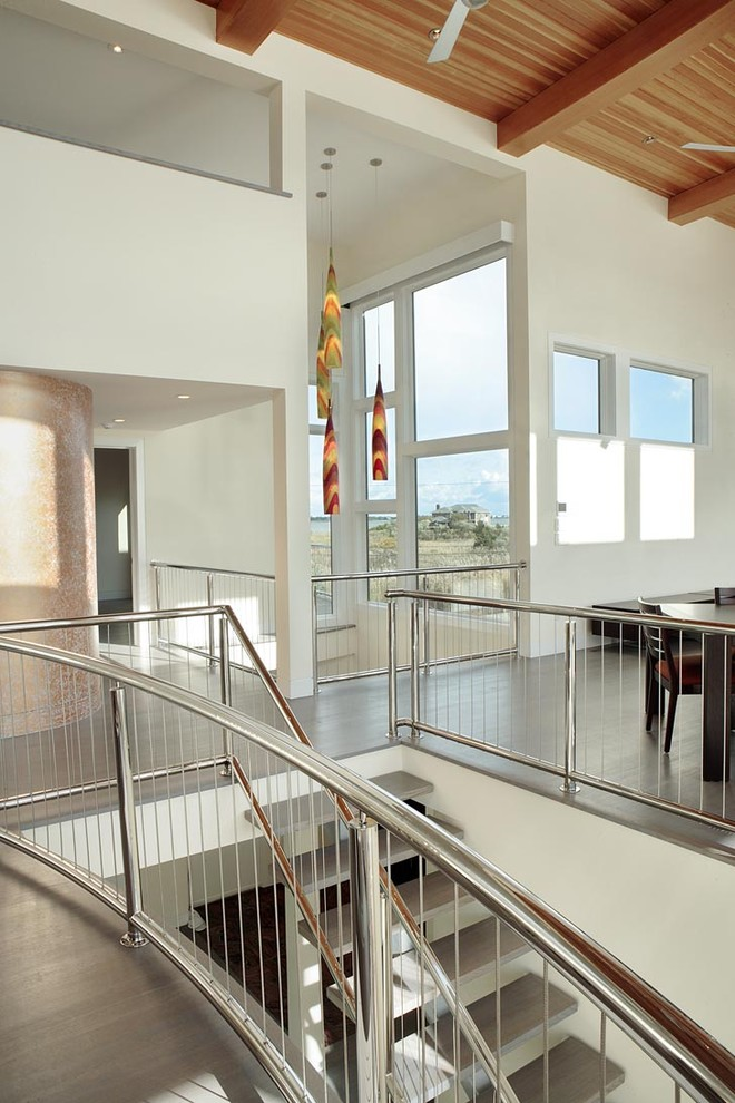 Staircase - contemporary open and cable railing staircase idea in New York