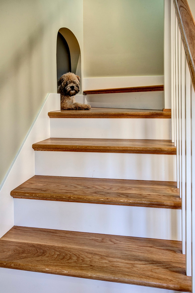 Inspiration for a craftsman wooden staircase remodel in Seattle with painted risers