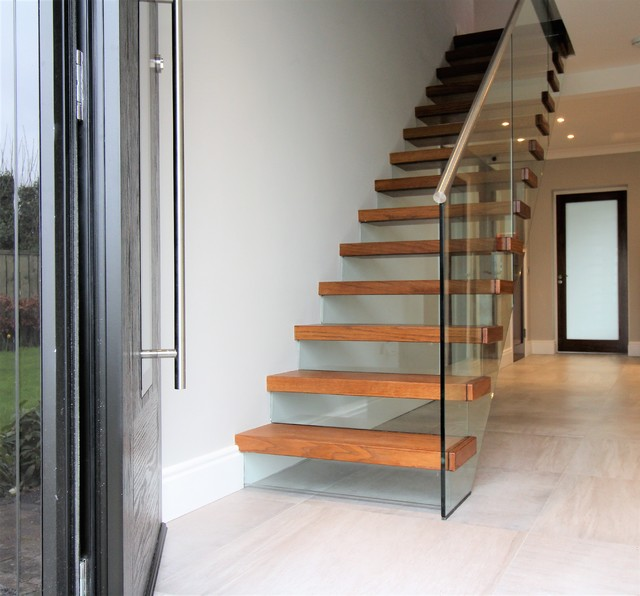 Cantilevered Stairs With Glass Balustrade And Risers Modern Staircase
