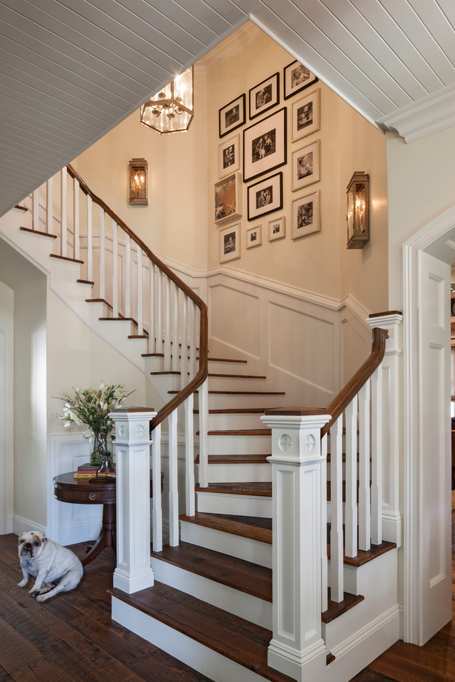 Large coastal wooden curved staircase photo in Los Angeles