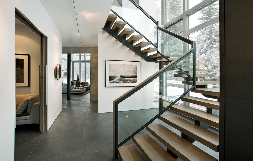 Staircase - modern wooden open and glass railing staircase idea in Denver