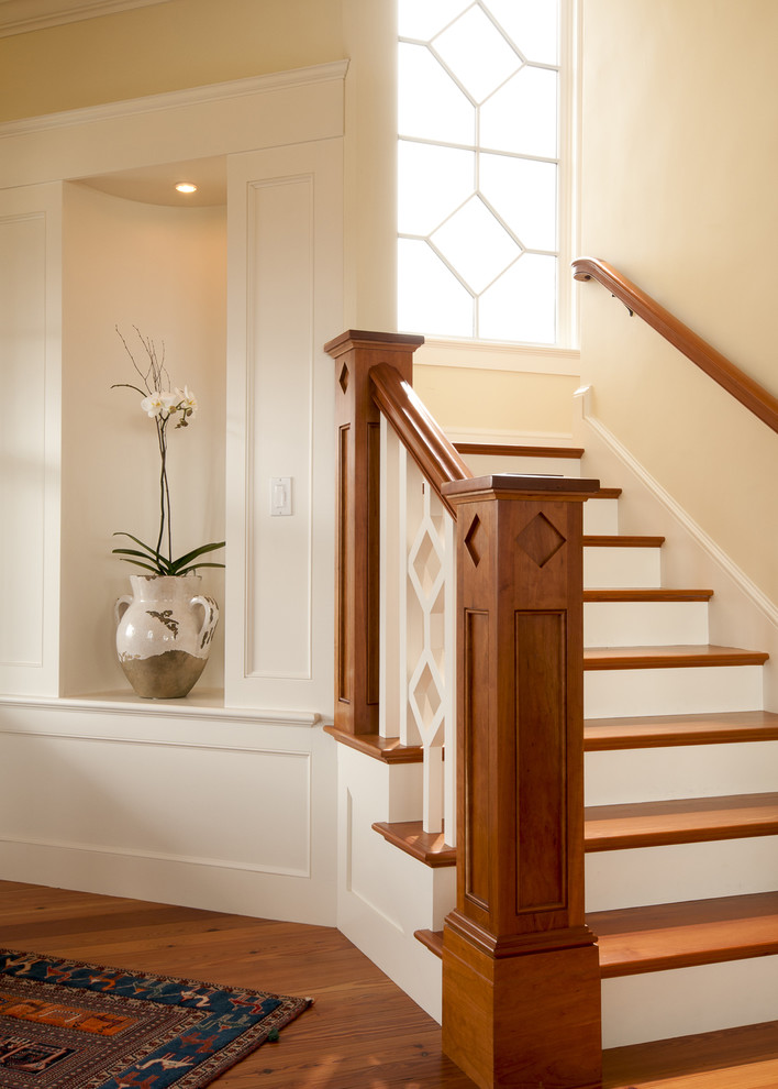Example of an ornate wooden staircase design in Boston