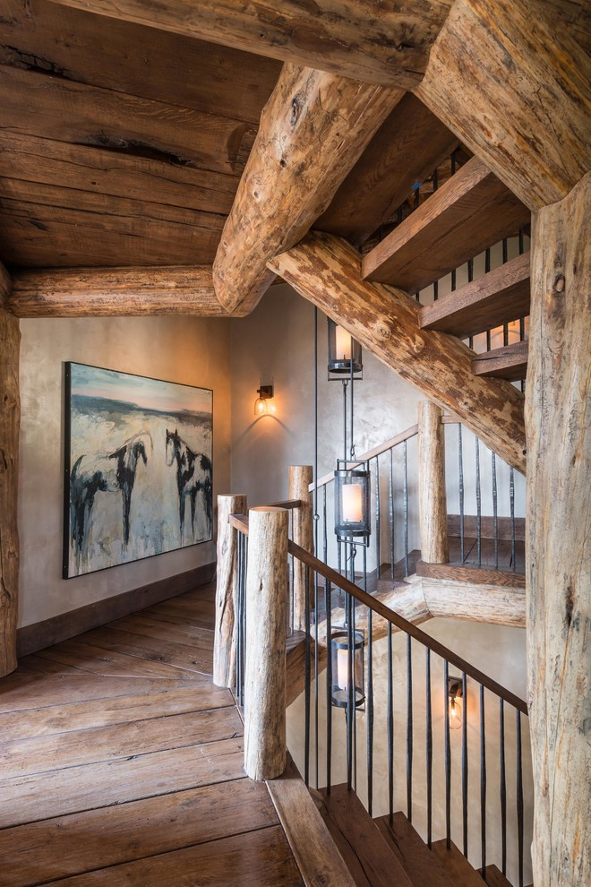 Staircase - rustic wooden u-shaped open staircase idea in Other