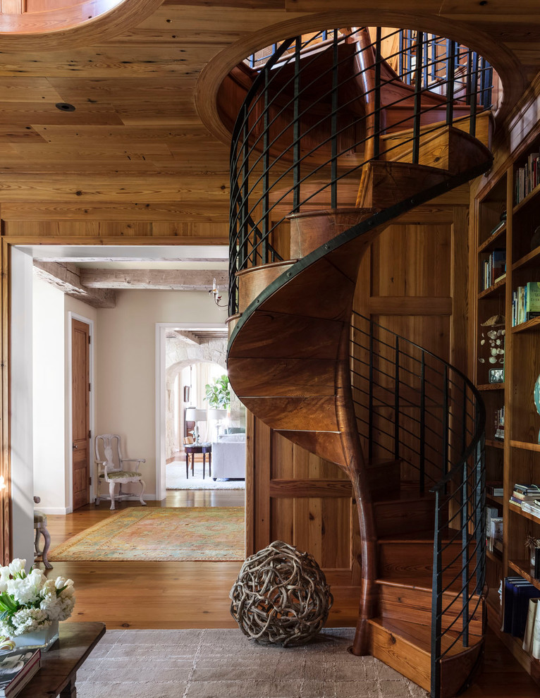 Staircase - transitional wooden spiral staircase idea in Dallas with wooden risers