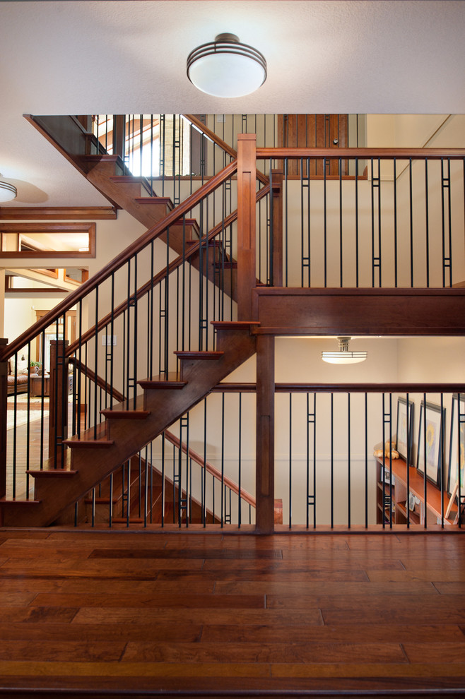Example of an arts and crafts wooden u-shaped mixed material railing staircase design in Edmonton
