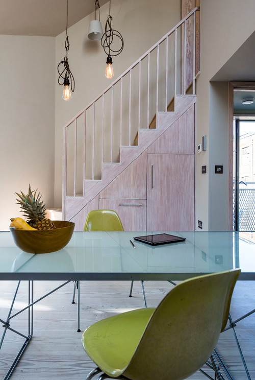 Clever ways to create staircase storage for Dining room under stairs