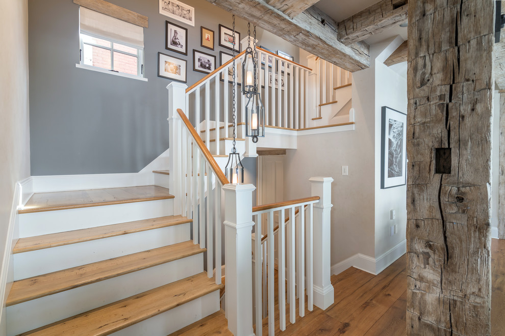 Farmhouse wooden l-shaped wood railing staircase photo in Denver with painted risers