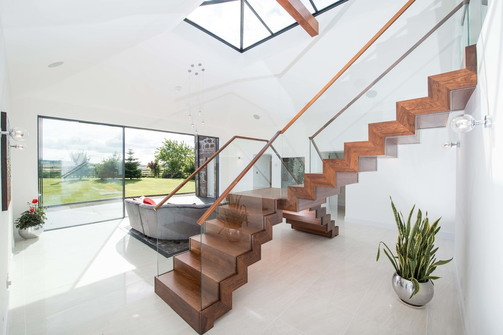 Inspiration for a mid-sized contemporary wooden l-shaped glass railing staircase remodel in Other with wooden risers