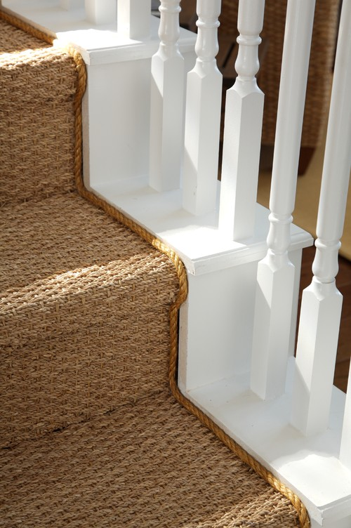 coastal style staircase with seagrass runner