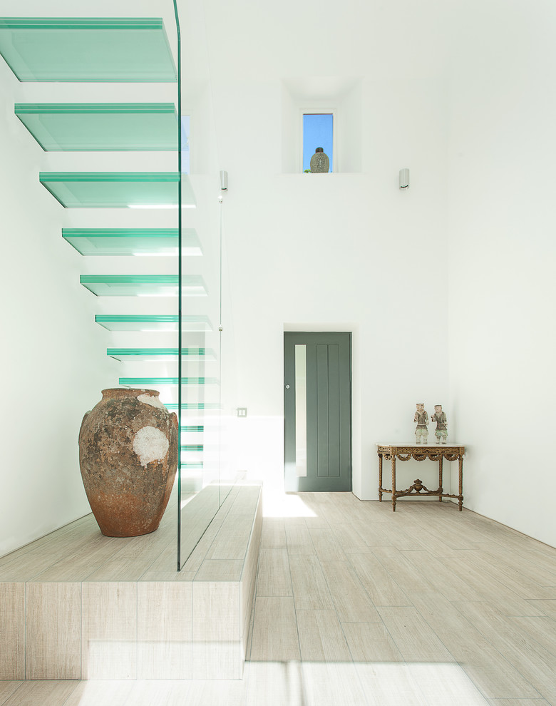 Inspiration for a contemporary glass open staircase remodel in Hampshire