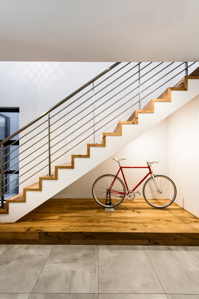 Example of a mid-sized trendy wooden straight staircase design in Perth with wooden risers