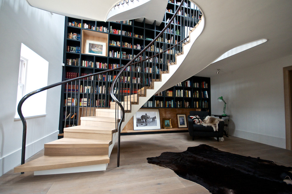 Staircase - huge contemporary wooden curved staircase idea in Kent with wooden risers