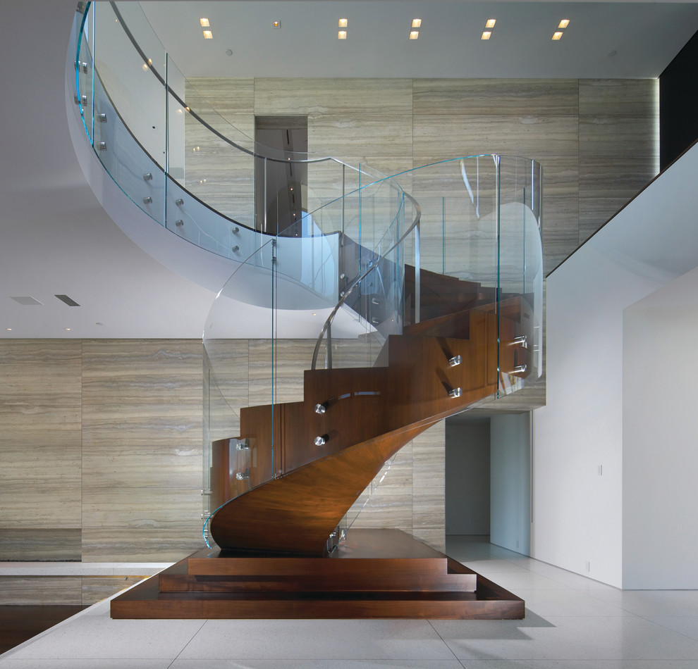 Example of a large trendy wooden curved staircase design in Orange County