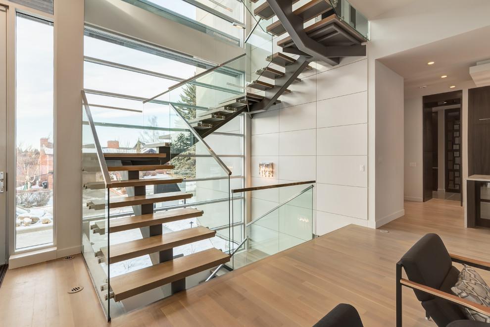 Staircase - contemporary wooden open staircase idea in Calgary