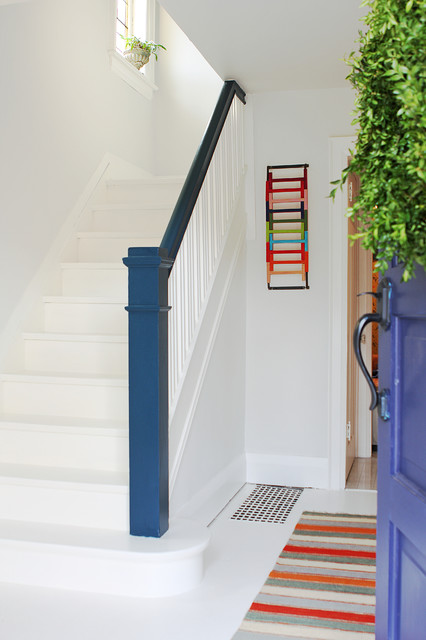 Trendy painted l-shaped staircase photo in Toronto with painted risers