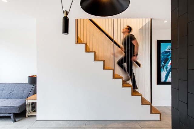 Inspiration for a small modern wooden straight metal railing staircase remodel in London with wooden risers