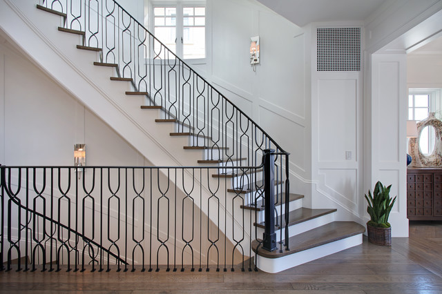 Staircase - large transitional wooden curved staircase idea in Orange County with painted risers