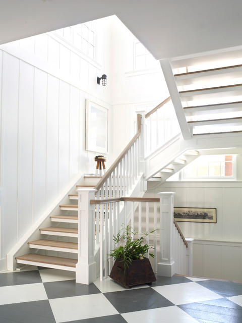 Example of a coastal wooden u-shaped open staircase design in San Diego