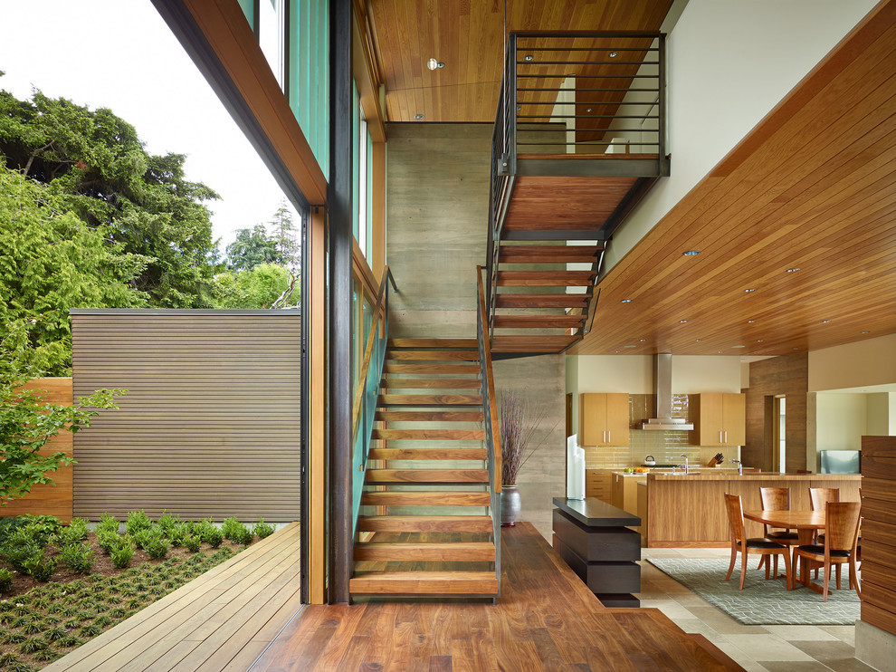 Inspiration for a contemporary wooden u-shaped open and metal railing staircase remodel in Seattle