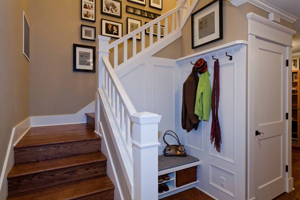 Staircase - mid-sized traditional wooden u-shaped staircase idea in Portland with wooden risers