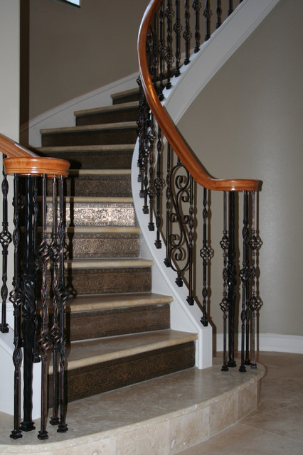 Mediterranean Staircase Tower : Curved stair project torres residence titusville fl