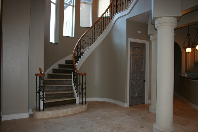 Curved Stair Project. Torres Residence. Titusville Fl mediterranean-staircase