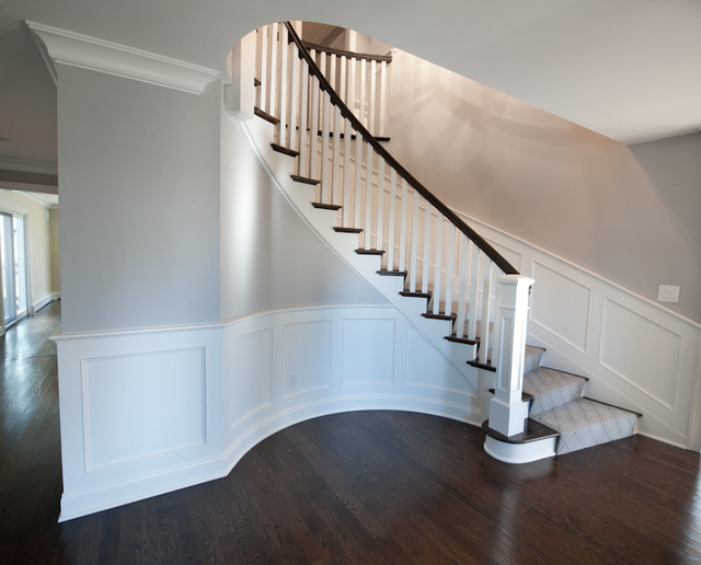 Curved Staircase Wood Paneling Transitional