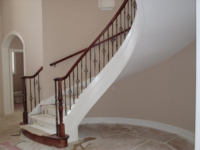 Curved stairs with metal pickets staircase london by for Curved staircases