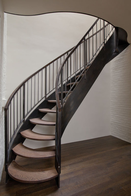 Curving steel stair transitional staircase new york for Pre built stairs interior