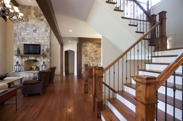 Cuscowilla lake home indian trail traditional for Interior staircase designs india